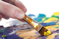 Somebody is painting something with paintbrush Royalty Free Stock Photo
