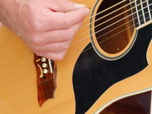 Somebody playing guitar. Somebody is playing on a guitar Stock Image