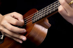 Somebody playing ukulele Royalty Free Stock Images