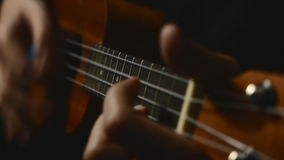 Somebody playing ukulele. stock video footage