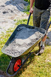 Somebody pushing the wheelbarrow Royalty Free Stock Photo
