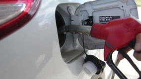 Somebody Sets to Petrol Tank the Discharge Nozzle. Somebody turns off cover of the car gasoline tank and put the discharge nozzle inside stock video footage