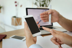Somebody shows something on the phone screen. Humans hands Stock Photo