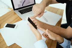 Somebody shows something on the phone screen. Humans hands royalty free stock photography