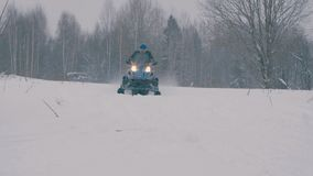 Somebody on snowmobile riding stock footage