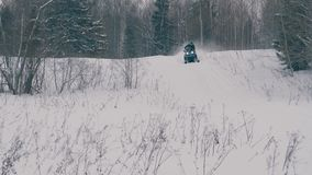 Somebody on snowmobile riding stock video