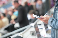 Somebody write in his noticebook. Somebody write something in his noticebook during reporting from a sports event football game Royalty Free Stock Photos