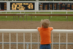 Someday. Young boy deep in thought at race track Royalty Free Stock Photos