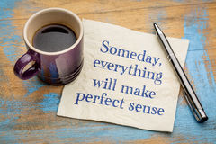 Someday, everything will make perfect sense. Someday, eveything will make perfect sense - handwriting on a napkin with a cup of espresso coffee royalty free stock images