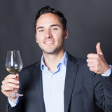 Somelier approving a glass of white wine Stock Photos