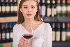 Somellier Wine Business Alcohol Drink Store Concept. Somellier young elegant female in a wine store professional Royalty Free Stock Image