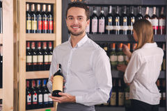 Somellier Wine Business Alcohol Drink Store Concept. Somellier young male and female choosing wine drink Royalty Free Stock Photos