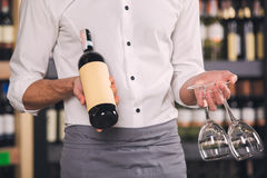 Somellier Wine Business Alcohol Drink Store Concept. Somellier young man holding wine bottle and glasses Stock Photo