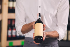 Somellier Wine Business Alcohol Drink Store Concept. Somellier young man holding wine bottle professional Royalty Free Stock Photos