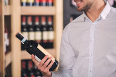 Somellier Wine Business Alcohol Drink Store Concept. Somellier young man holding wine bottle professional Royalty Free Stock Photo