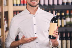 Somellier Wine Business Alcohol Drink Store Concept. Somellier young man holding wine bottle professional Royalty Free Stock Image