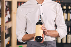 Somellier Wine Business Alcohol Drink Store Concept. Somellier young man holding wine bottle professional Stock Photo