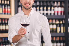 Somellier Wine Business Alcohol Drink Store Concept. Somellier young man holding wine glass professional Royalty Free Stock Photography