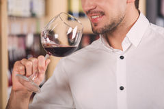 Somellier Wine Business Alcohol Drink Store Concept. Somellier young man holding wine glass professional Stock Photo
