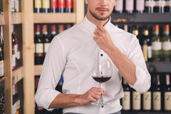 Somellier Wine Business Alcohol Drink Store Concept. Somellier young man holding wine glass professional Stock Images