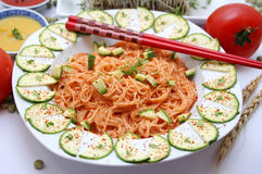 Somen. Japanese somen noodles with tomato sauce and zucchinis royalty free stock photos