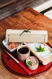 Somen - Japanese white noodle in bamboo plate with shoyu sauce. Somen - Japanese white wheat noodle in bamboo plate with chilled shoyu sauce Stock Images