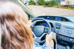 Somene driving car. Woman driving car at country asphalt road, view inside out Stock Photos
