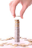 Someone add coin. To coin tower Royalty Free Stock Image