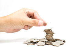 A someone add coin to coin tower. Someone add coin to coin tower Royalty Free Stock Photo