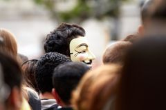 Anonymous in the middle of the crowd royalty free stock images
