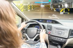 Somene driving car. Someone driving car at parking lot royalty free stock image