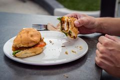 Someone eating a chicken burger for lunch in Australia stock photography