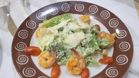 Someone eats Caesar salad with shrimps. 4k. close-up.  stock video