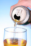 Someone fill glass with beer Stock Images