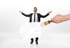 Someone hand painting businessman body white with brush Stock Photography