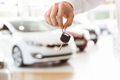 Someone holding car keys by his fingertips Stock Image