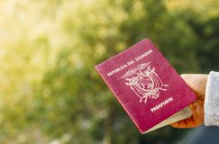 Someone holding a passport from the Republic of Ecuador, isolated. Ecuador is in South America Royalty Free Stock Photography