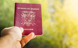Someone holding a passport from the Republic of Ecuador,. Ecuador is in South America Stock Photography