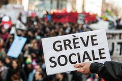 Someone Holding a Sigh Saying greve social. MONTREAL, CANADA, APRIL 02 2015. Riot in the Montreal Streets to counter the Economic Austerity Measures. Someone stock photo
