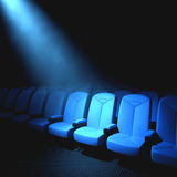 Someone Important. Spotlight on an empty chair. Concept of someone important to arrive Stock Image