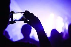 Someone opowiada obrazek podczas koncerta Zdjęcie Royalty Free