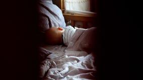 Someone peeps over the sleeping little boy