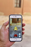 Someone playing the Pokemon Go game Stock Images