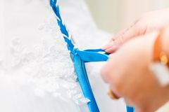 Someone is preparing bride's corset Royalty Free Stock Photos