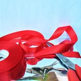 Someone is preparing to wrap a gift box. A group of wrapped gift boxes for someone special in greeting moments. They're decorating with red satin ribbon. For royalty free stock image