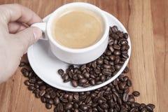 Someone raises coffee Royalty Free Stock Photo