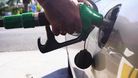 Someone refueling car stock footage