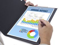 Someone reviewed annual report. Someone reviewed annual report for his business on white background Stock Photos
