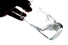 Someone shaking a solvent. Hand shaking water in a chemical measure glass , isolated on white Stock Photo