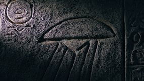 Torch Lights Up Ancient UFO Wall Carving